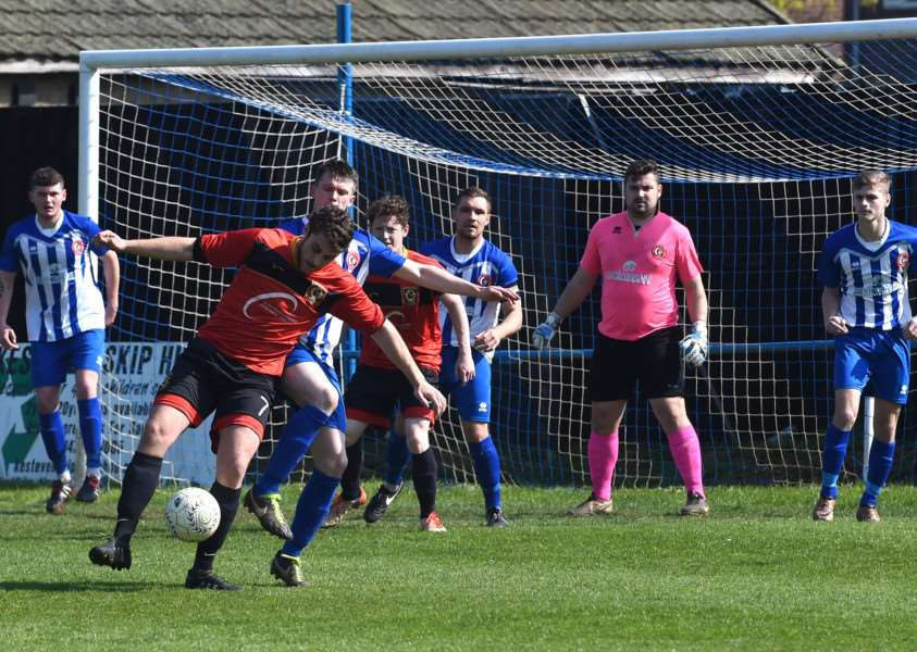 Action from Harrowby United's win over Huntingdon Town on Saturday. Photo: Toby Roberts