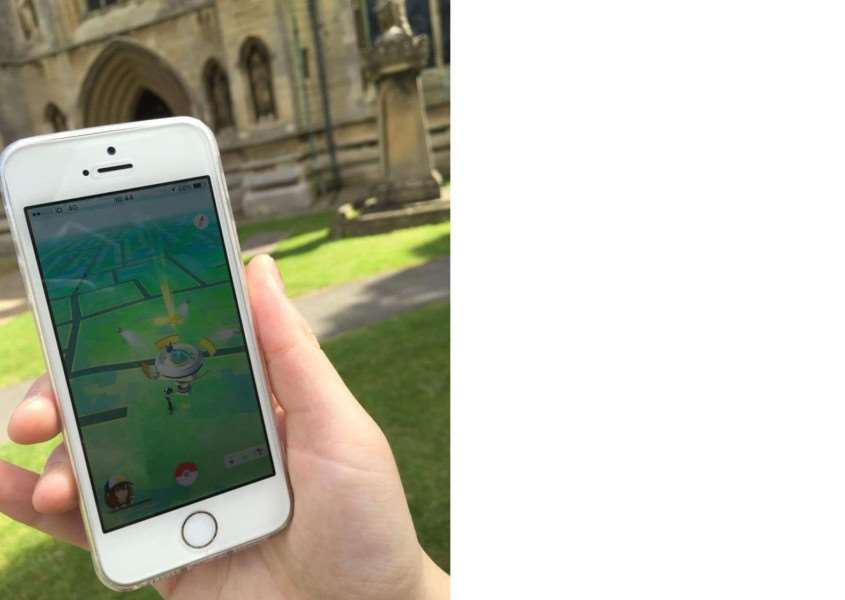 Playing Pokemon Go at St Wulfram's Church.