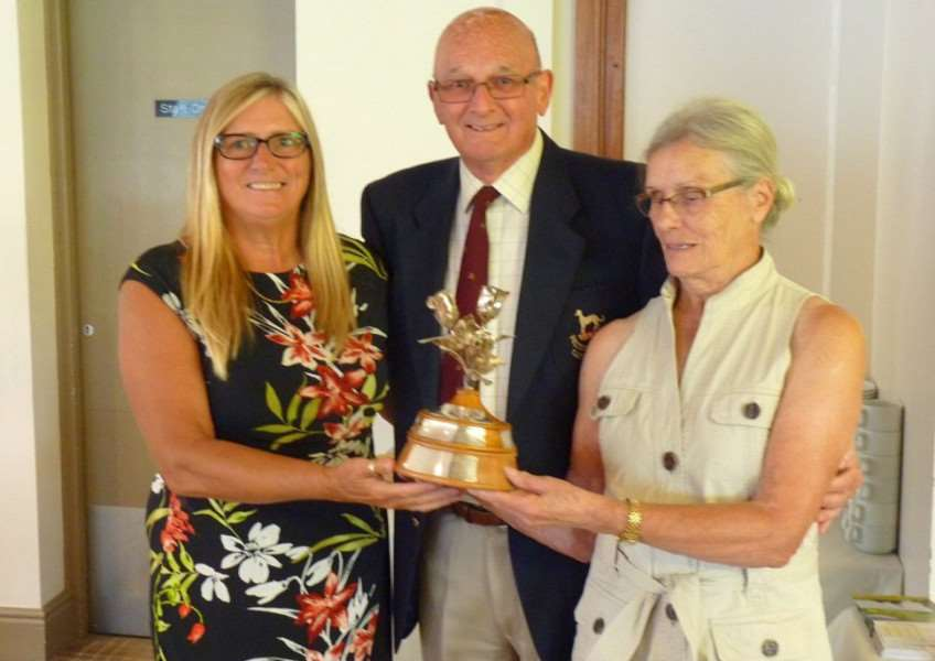 From left - Linda Moss (Toft GC) and David Burnett presenting the Enid Burnett Trophy to the Belton Park lady winner Ina Wood.