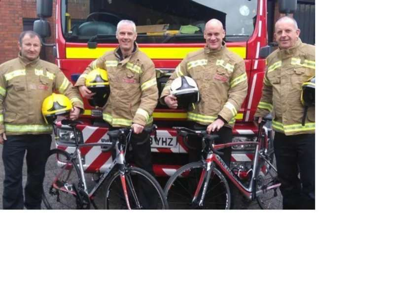 Green Watch Grantham Fire Station riders Clive Baillie and Kyle Campbell with their support crew Pete Scarlett and Craig Tuck.
