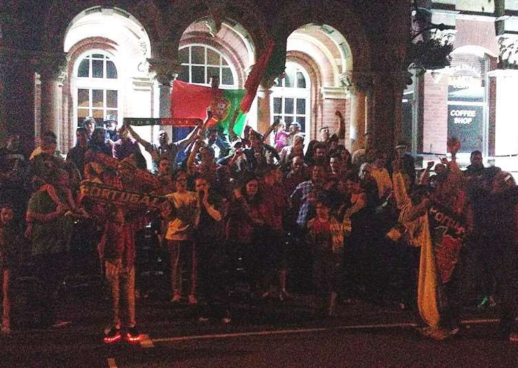 Portuguese fans celebrate outside the Guildhall in Grantham.