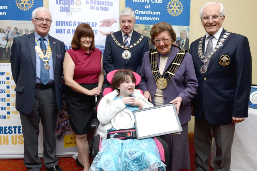 Children of Courage 2016: Winner Jade Illingworth, with from left back row, president of the Rotary Club of Grantham Kesteven, Chris Thurlow, Jade's mum Dawn, SKDC chairman Ray Wootten, Mayor of Grantham Jacky Smith and Rotary district governor Geoff Blurton,