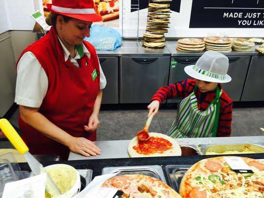 Stanley Jackson made pizza during his day in charge at Grantham's Asda.