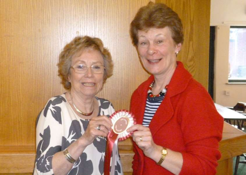 Lady secretary Julia Bishop and lady captain Sheila Mason share the winners' rosette.