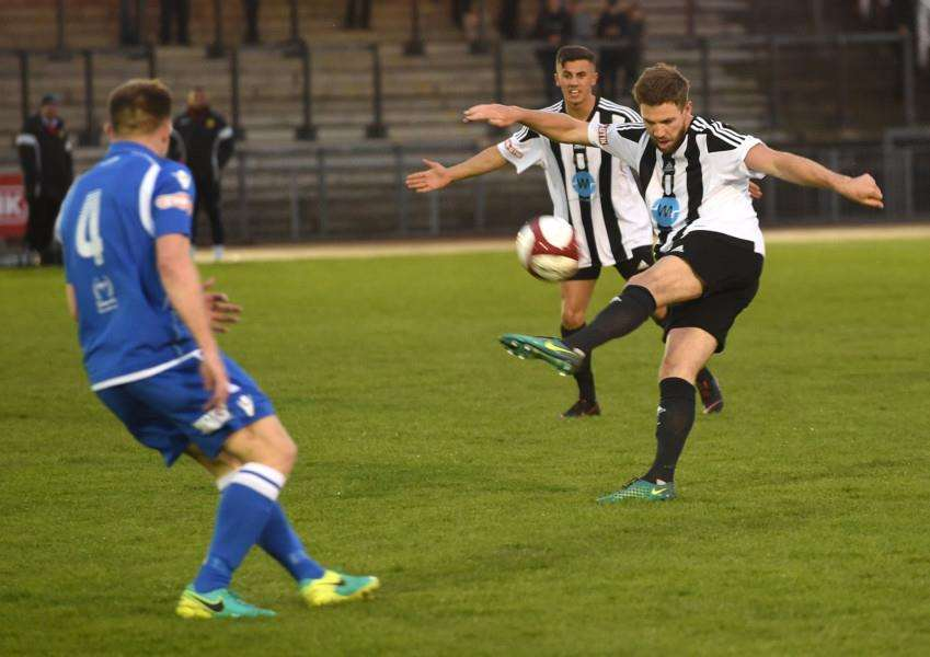 Grantham Town striker Jordan Hempenstall tries a half-volley on Tuesday night. Photo: Toby Roberts