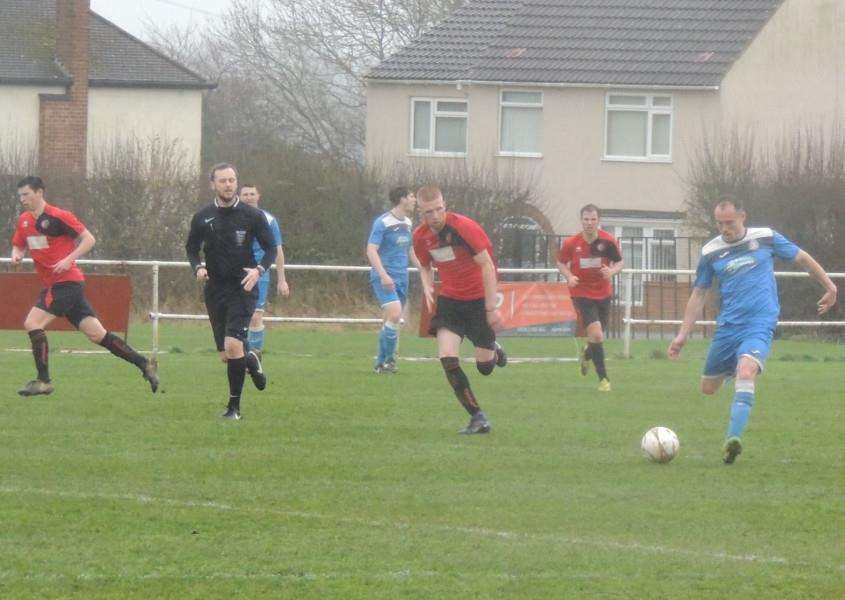 Dan Grainger sets up another Desborough attack, tracked by George McCartney.