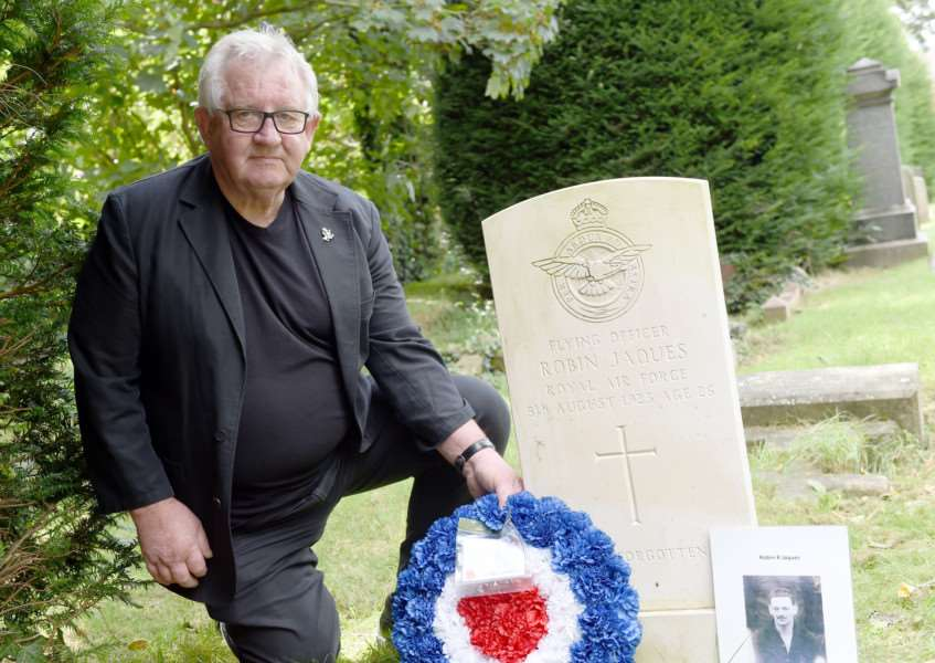 John Jacques, grandson of Robin Jaques and nephew of comedy actress Hattie Jacques, next to his grandfather's headstone in Grantham Cemetery'TRP-13-8-2016-941A (1) EMN-160816-142654001