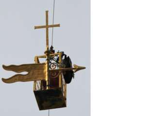 The weathervane travels to the top of the spire of St Wulfram's Church in Grantham. Photo: Roger Graves