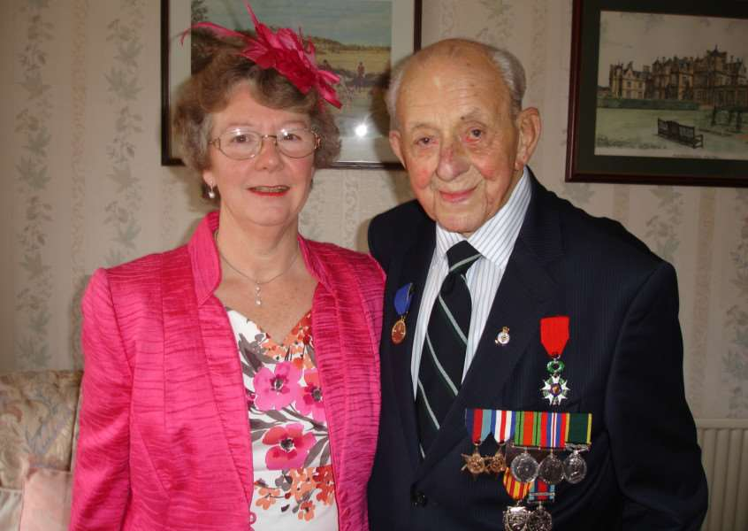 Pictured with his wife Diane, WWII veteran Jack Bond proudly wears his vast collection of medals, including the Legion d'honneur.