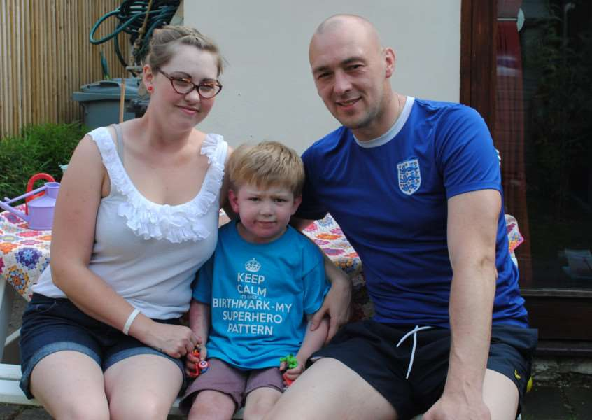 Surrounded by his parents Larissa and Mark, four-year-old Alfie King is undeterred by his condition.