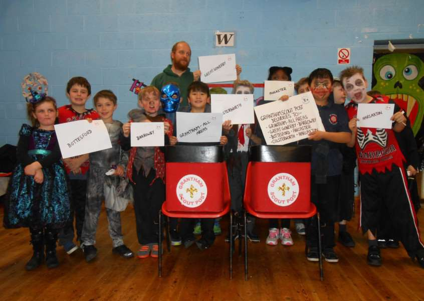 Grantham Scouts with their post boxes at a Halloween party.