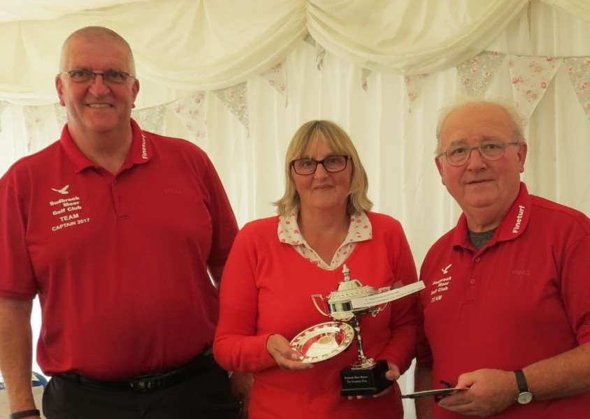 Sudbrook Moor senior captain David Guy presenting the Friendship Cup to winners Sue Watson and Graham Mackinder.