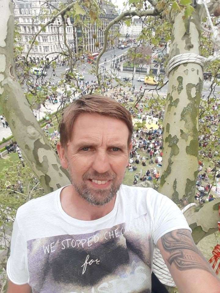 Ben McGorty in a tree in Parliament Square as part of the Extinction Rebellion protest. (9032203)