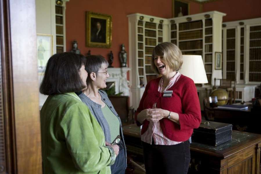 National Trust Volunteers and Room Guide in the Library at Belton House.