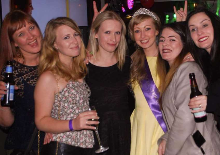 Ms Manchester Galaxy and former Grantham schoolgirl Kayleigh Mansfield, fourth from left, with friends at her fund-raising evening at the King's Arms in Grantham. Photo: Alternative Annie