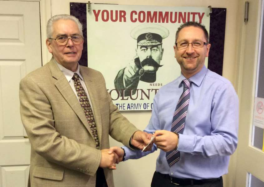 A �500 cheque being presented to Grantham Poverty Concern on behalf of the Freemasons to Andy Maddison a volunteer for Grantham Poverty Concern.