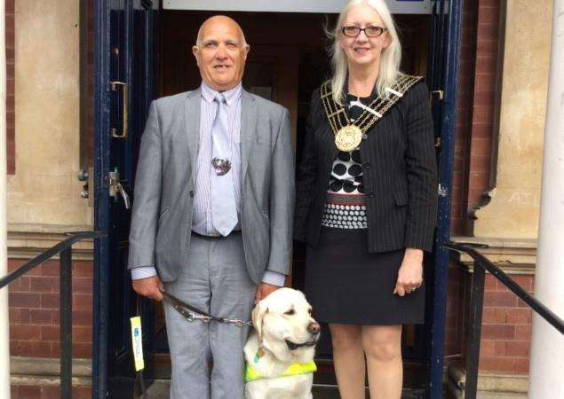Mayor of Grantham Coun Linda Wootten with Ian Wells and his guide dog Wheeler.