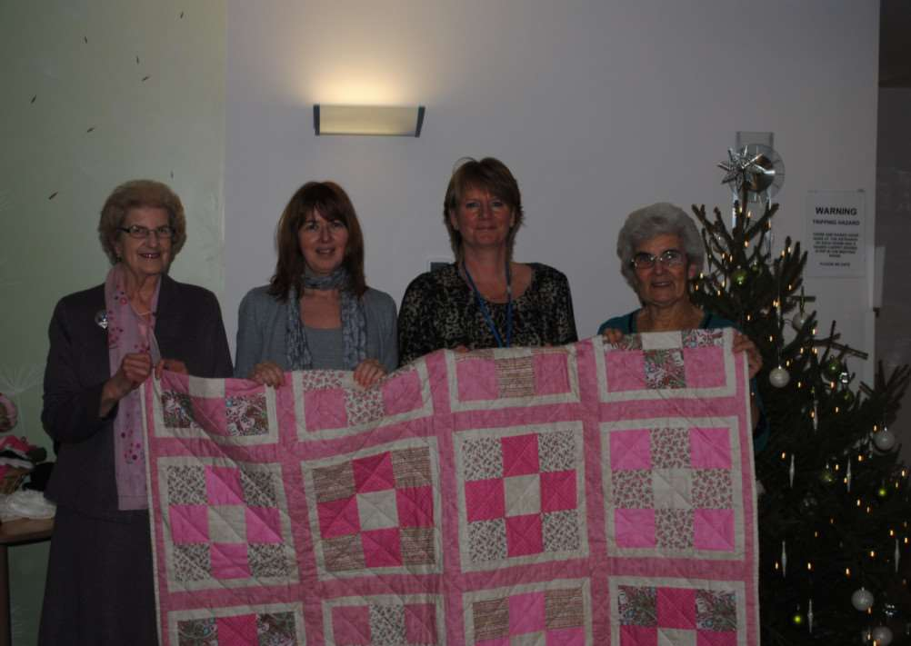 Tina Dingley and Janie McCormick of St Barnabas Hospice, centre, receive the fund-raising quilt from Maureen Smith and Sheila Marshall.