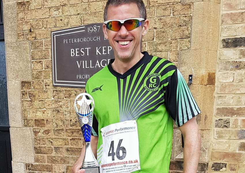 Matthew Kingston-Lee with his winners' trophy at the Thorney Five Mile Road Race on Sunday. Photo: Matthew Kingston-Lee/Robert McArdle