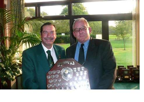 Belton Park scratch team captain Nigel Harris receives the South Lincs winners' shield from county president Jim Lammin.