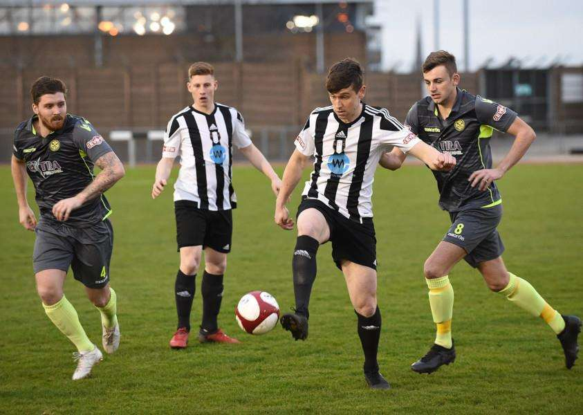 Grantham Town midfielders Jack McGovern and Andrew Wright control their territory at The Meres on Tuesday night. Photo: Toby Roberts