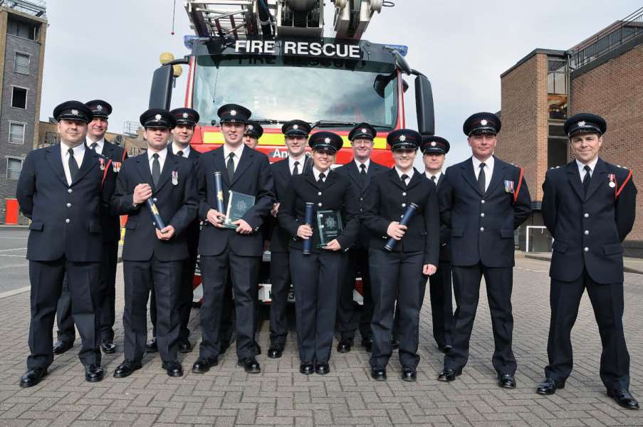 Recently recruited on-call firefighters during their passing out parade.