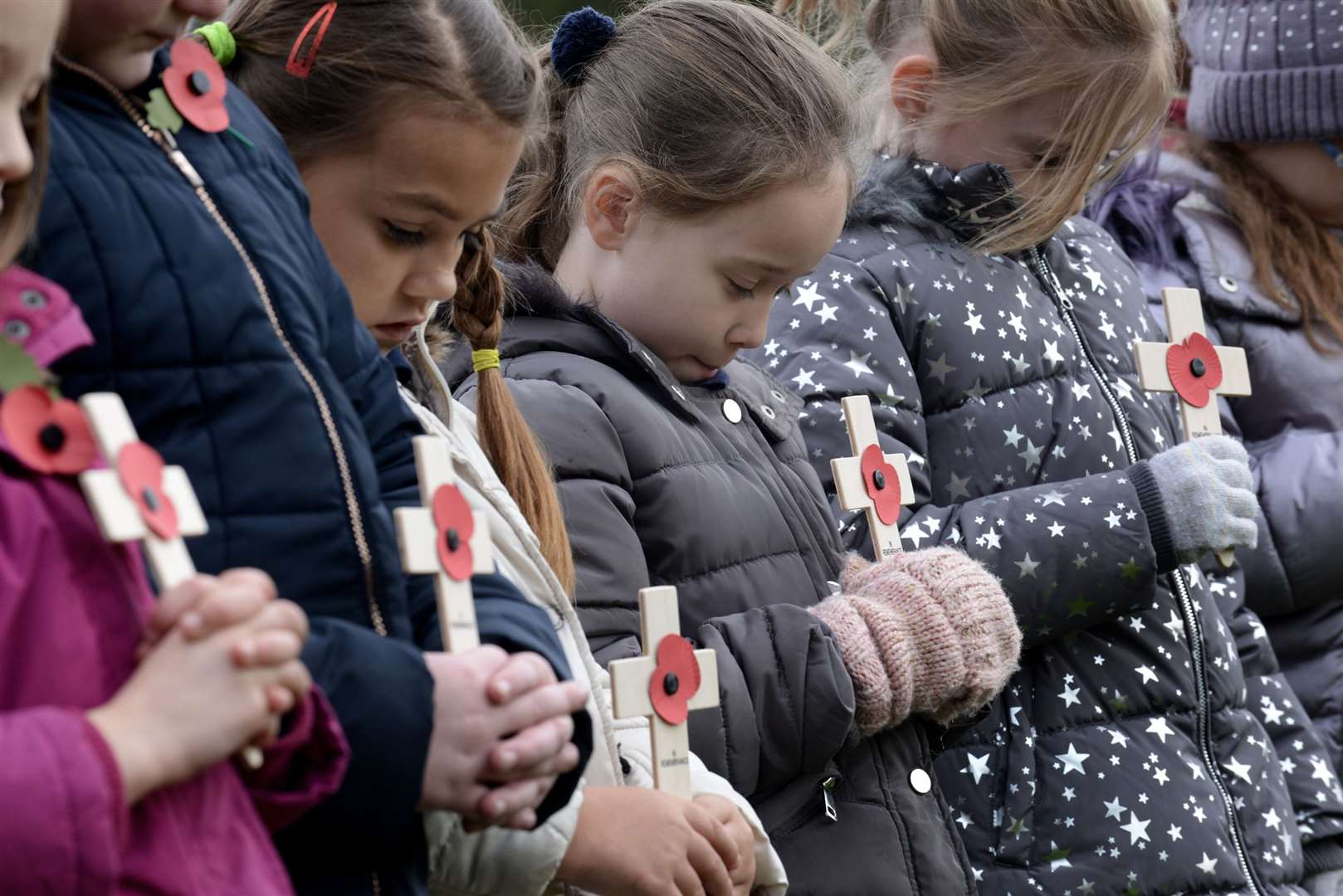Children from St Anne's Primary School pay their respects at the Remembrance service in Grantham Cemetery. (21077778)