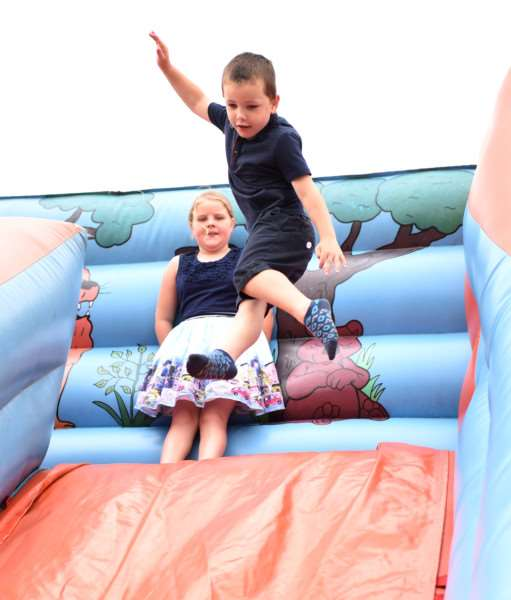 Vinnie Haggan enjoys the bouncy slide at the Danny Walsh memorial day.