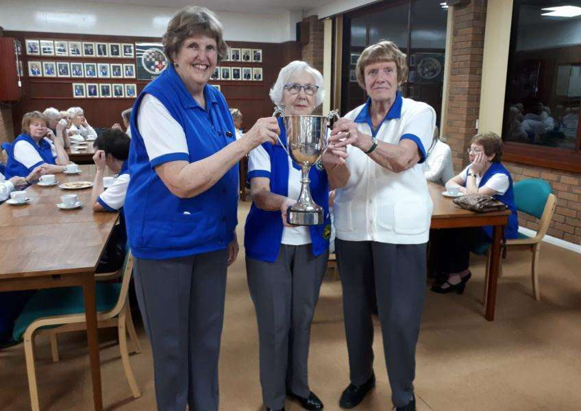 Muriel, Bette and Anne show off the Pat Wallwork Trophy.