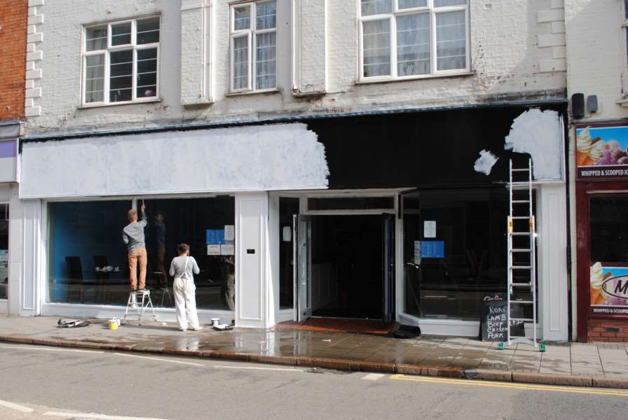 The front of Cafe Bleu was being painted when the flooding happened.