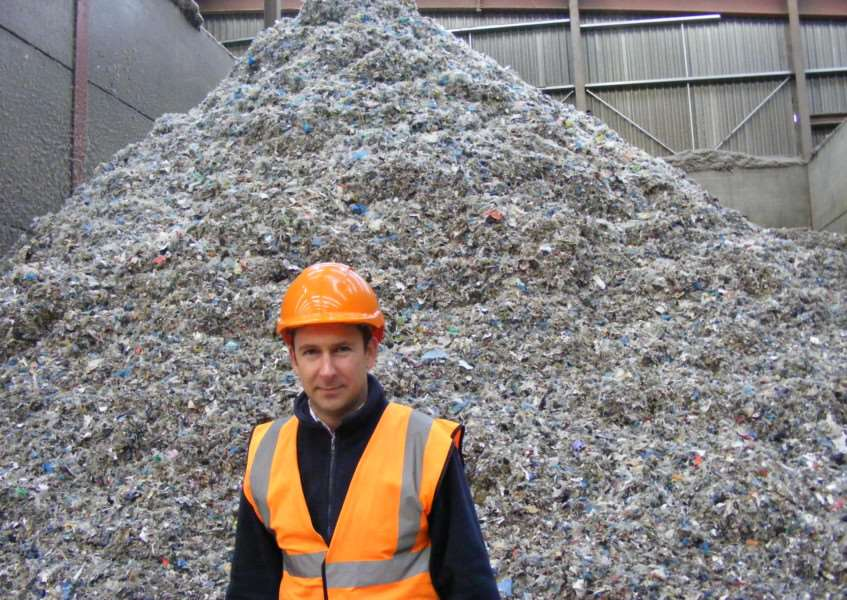 Managing Director of Mid UK Recycling, Chris Mountain, with a heap of shredded textiles destined for recycling as fuel. EMN-160202-093731001
