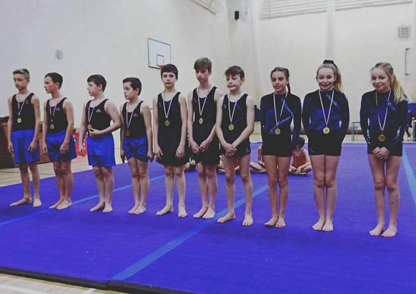 King's School under-14 boys floor and vault gold medallists Kaan Celik, Myles Sadler, Jake Dawson and Harry Clements, alongside Priory Ruskin Academy under-14 mixed floor and vault gold medallists Toby Doughty, Oliwier Wnukowski, Joe Taylor, Alisha Shepherd, Neeve Pexton and Isla Pexton.