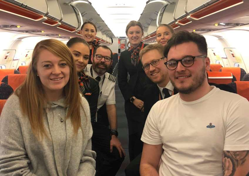 Hannah Pacey and Ben Lilley on their flight with easyJet staff after Ben's marriage proposal.