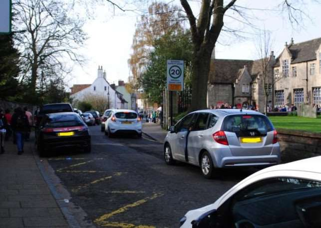 Parking outside the National Junior School in Grantham.