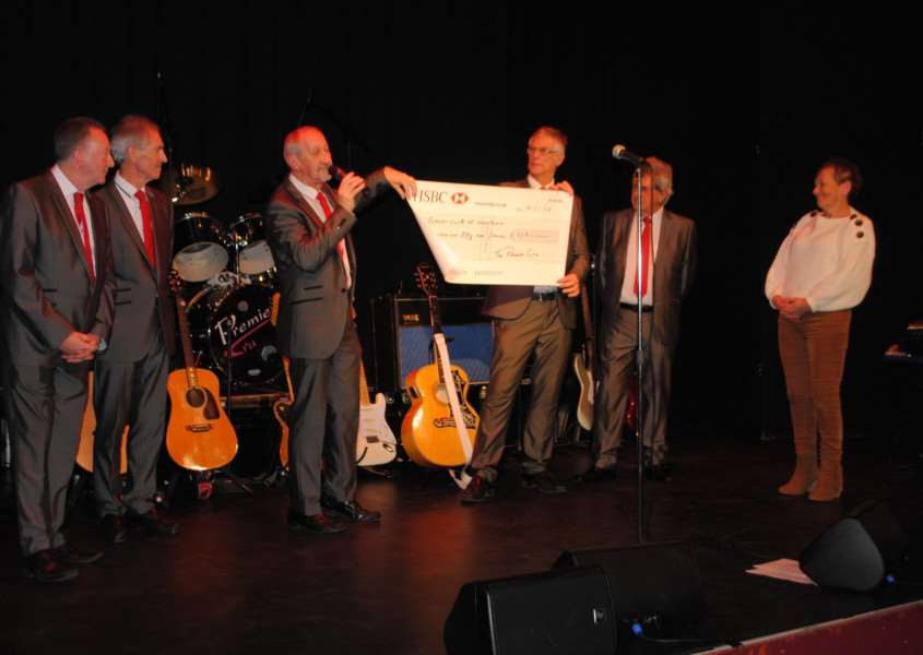 Premier Cru presented the cheque for �559 on stage.
