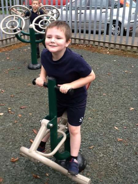 Pupils make the most of the new playground equipment thanks to a Lottery grant.