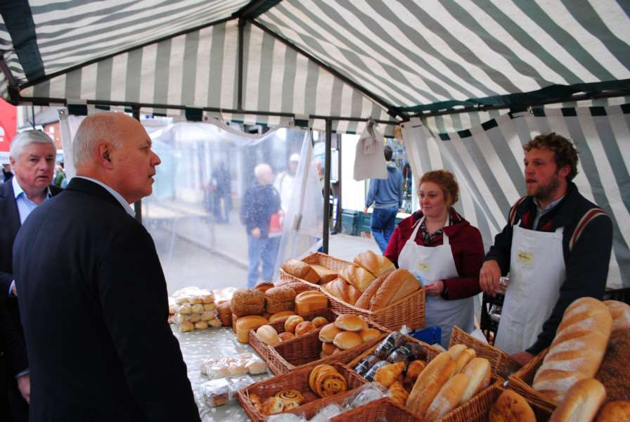 Iain Duncan Smith meets stall holders in Grantham market.