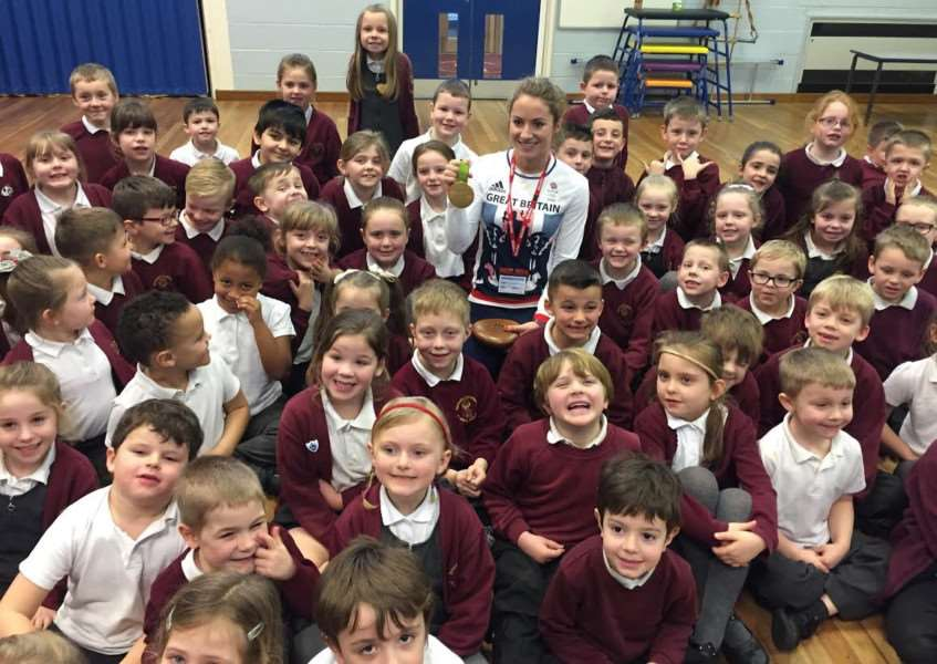 Olympic gold medallist Shona McCallin with pupils of Belmont Primary School