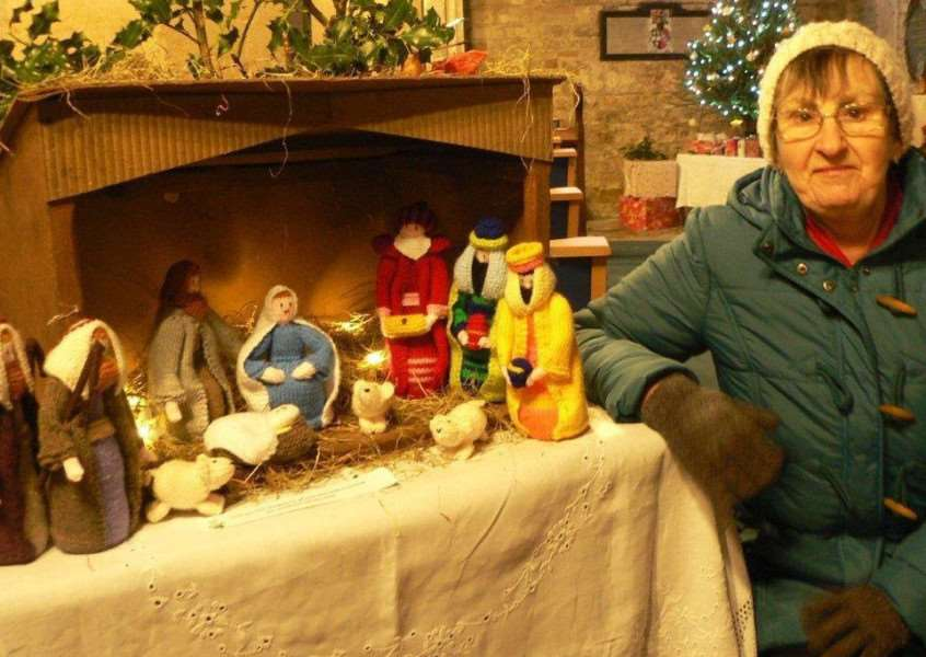 Pam Doughty with her knitted nativity scene.