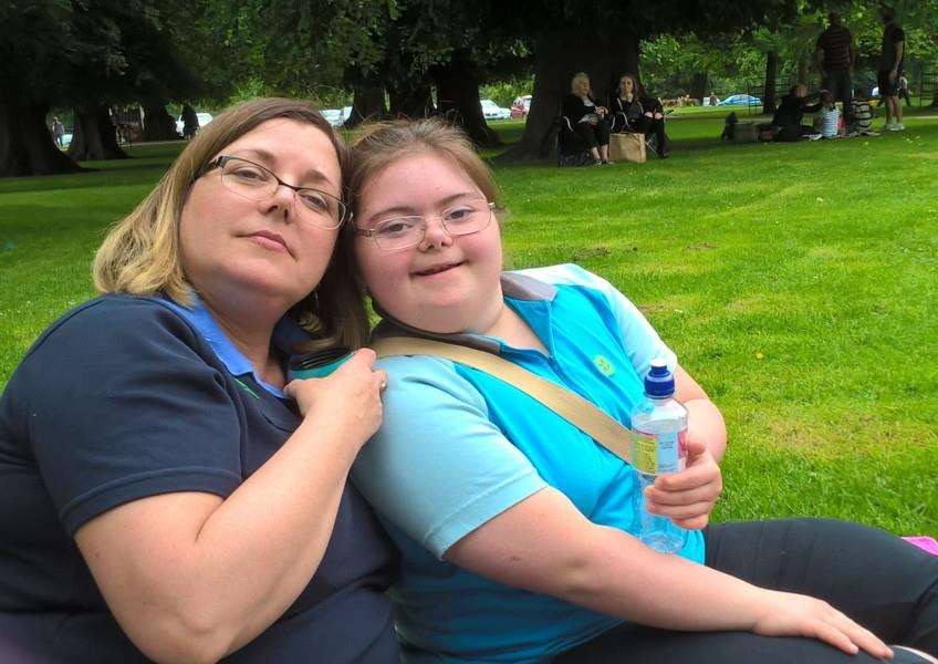 Georgia Broomfield, of 1st Barkston Guides, with her mum at the Queen's Birthday Picnic at Belton House.