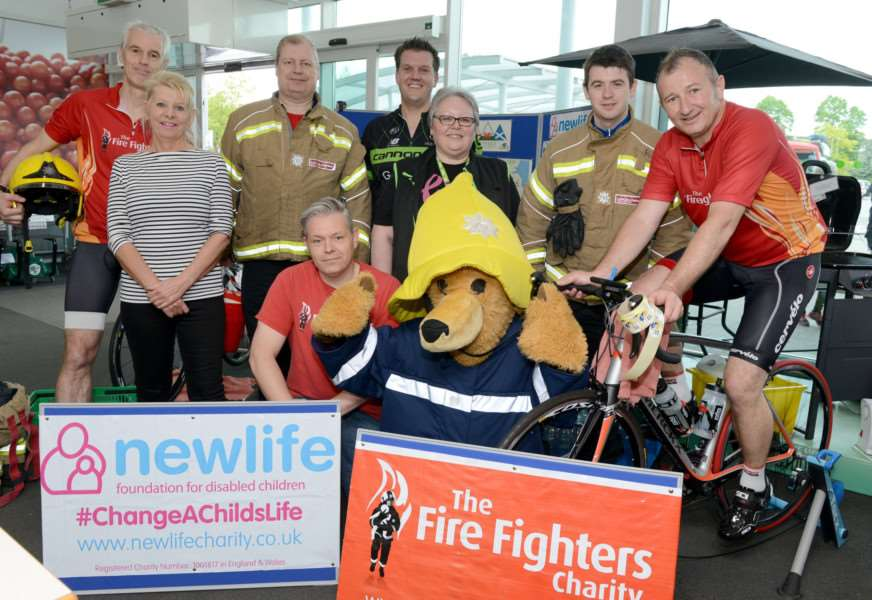 Grantham firefighters raise money for the Newlife and The Fire Fighters charities with a leg waxing at Asda.