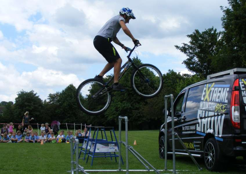 Danny Butler and his extreme mountain biking show wowed the youngsters at Ancaster School at the end of their cycling day. EMN-160624-165700001