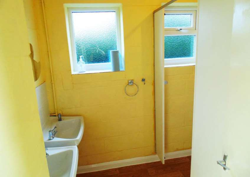 One of the cloakrooms with new sinks, tiles and toilets fitted by Sunrisers...painted 'Sunrise' yellow.