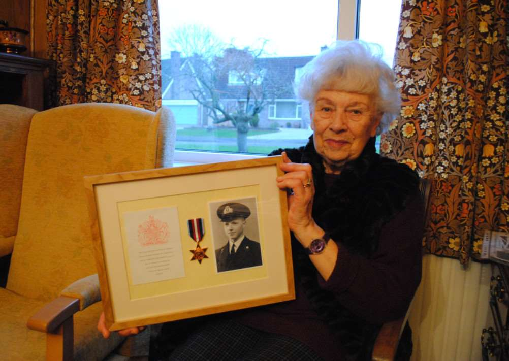 Mollie Kidd with the Arctic Star medal awarded posthumously to her husband Tim. Photo: 0300A