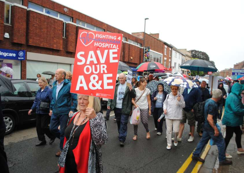 Protesters march through Grantham town centre.