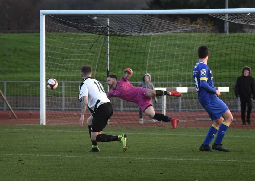 Lee Shaw puts Grantham Town 3-1 up just before half time. Photo: Toby Roberts