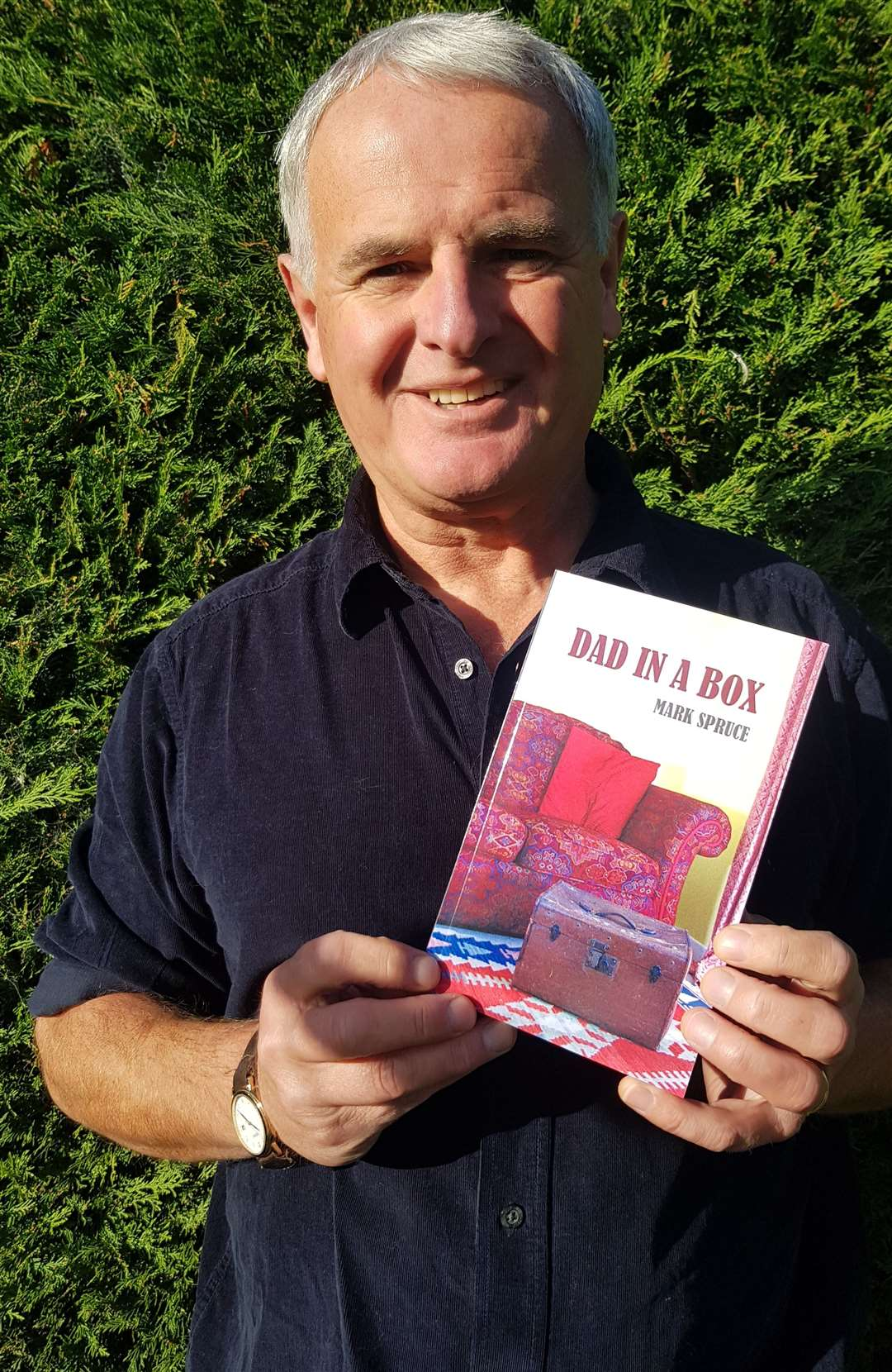 "Mark Spruce, with his book ""Dad in a box"" (42839771)"