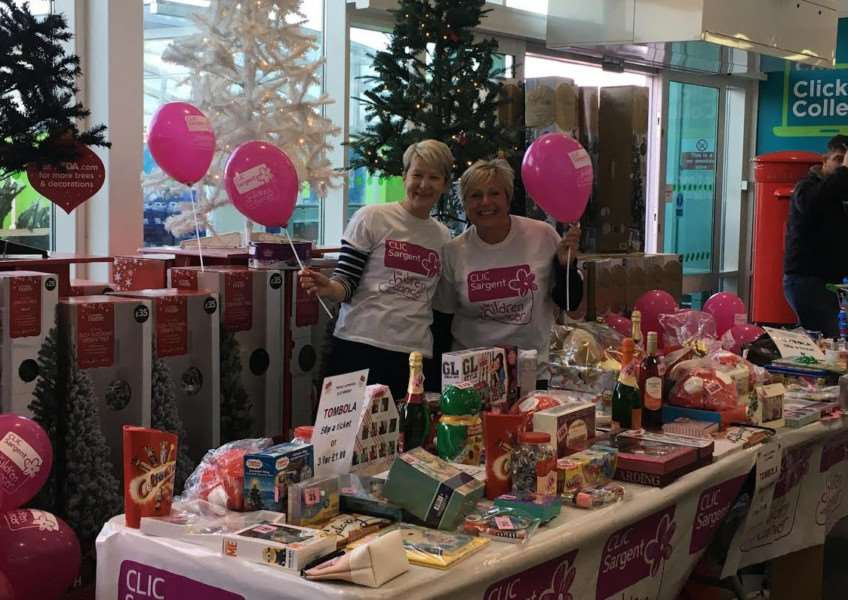 Julie Gilbert and Rachel Pattison at a tombola stall they manned in Asda last month, raising �617.