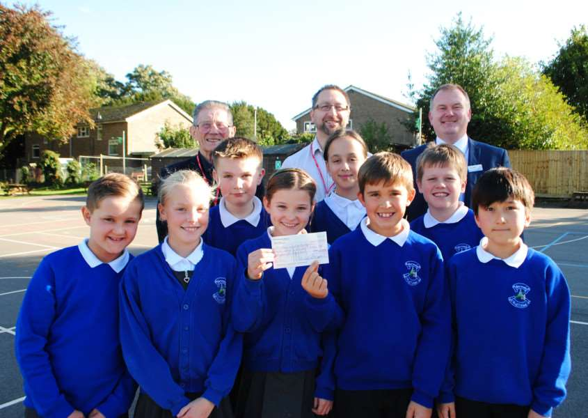 Barrowby Primary School's fundraising committee presents Grantham passage with a cheque for �182.50. With the pupils are, from left, Mike Monaghan and Andy Maddison, of Grantham Passage, and headteacher Len Batey.