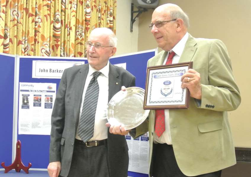 John Barker (left) presenting the salver to John Hart at Community Lincs AGM